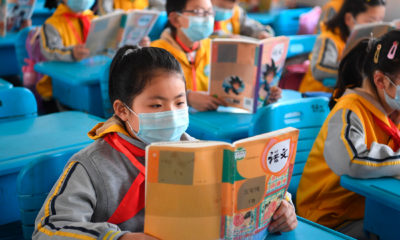 China busca reanudar clases